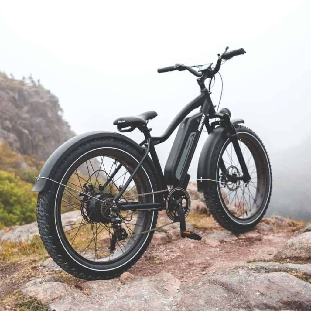 Fat tire electric bike on the cliff of a mountain.
