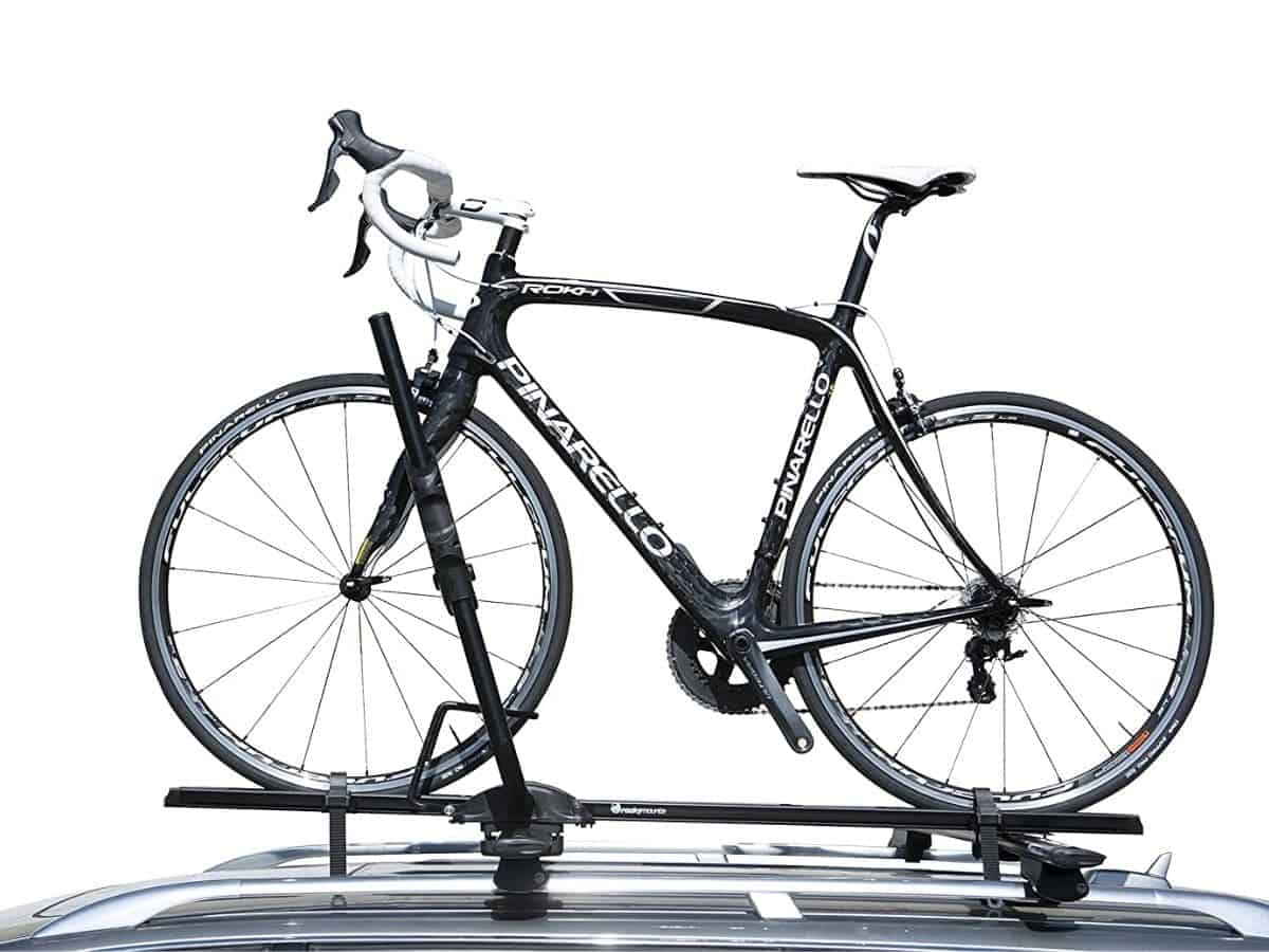 Bike attached to a RockyMounts roof rack on a car.