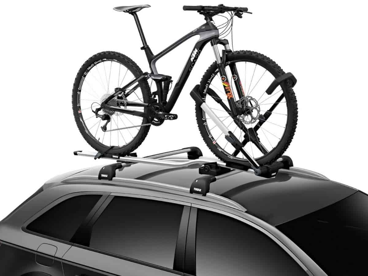 Bike on a Thule roof-mounted rack on an SUV.
