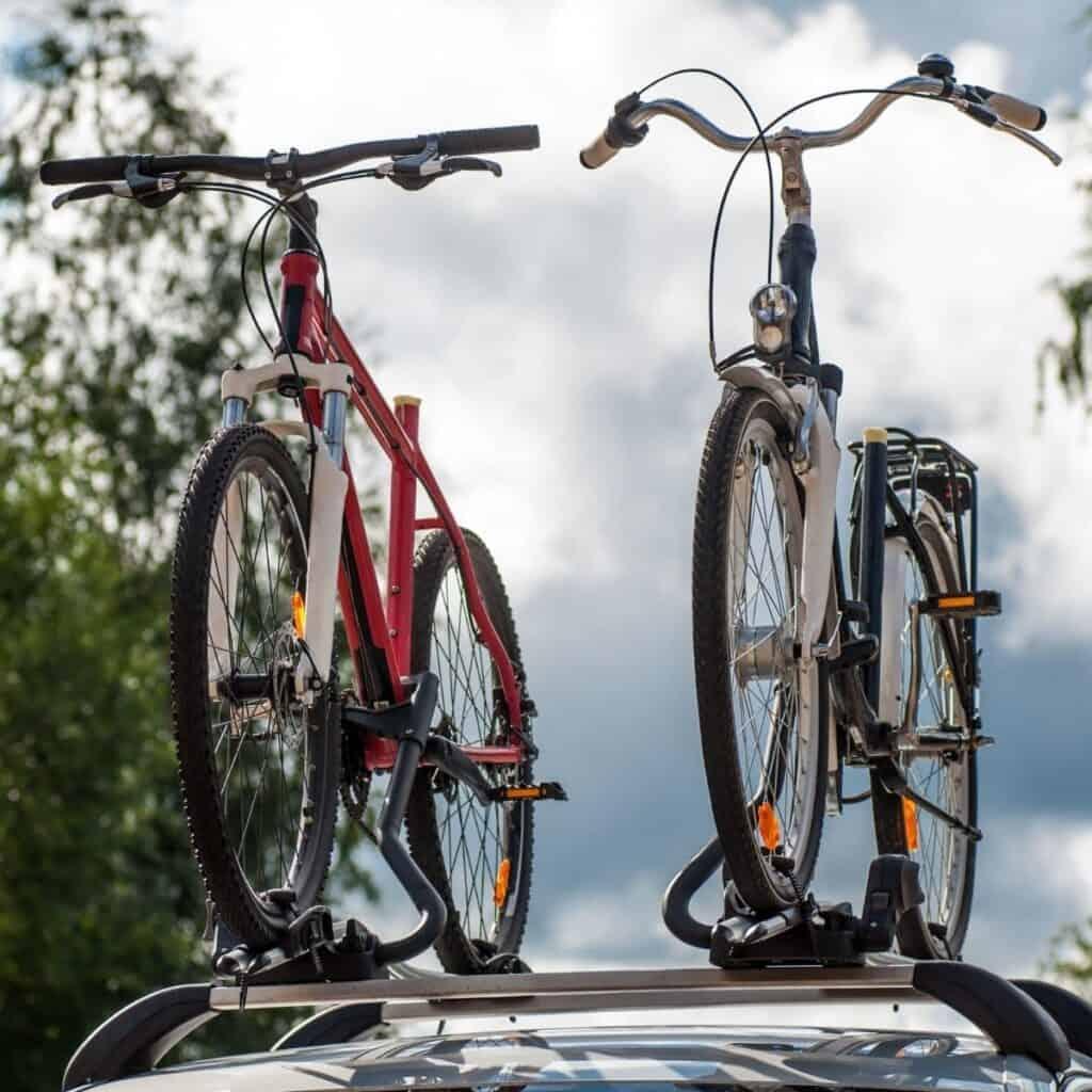 Two bikes on a roof-mounted car bike rack.