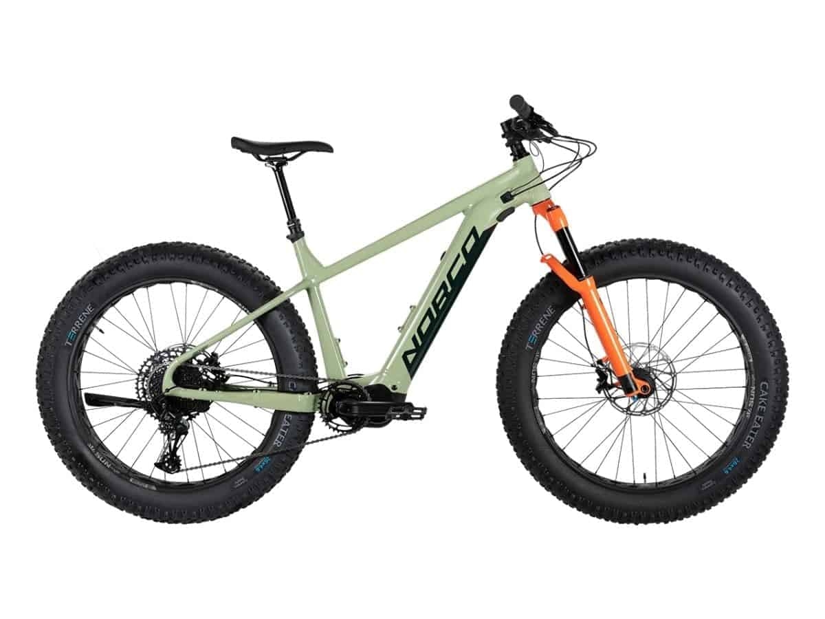 Norco green and orange fat tire electric bike.
